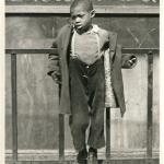 Boy with Arms Around Gate, Bedford-Stuyvesant, c1949